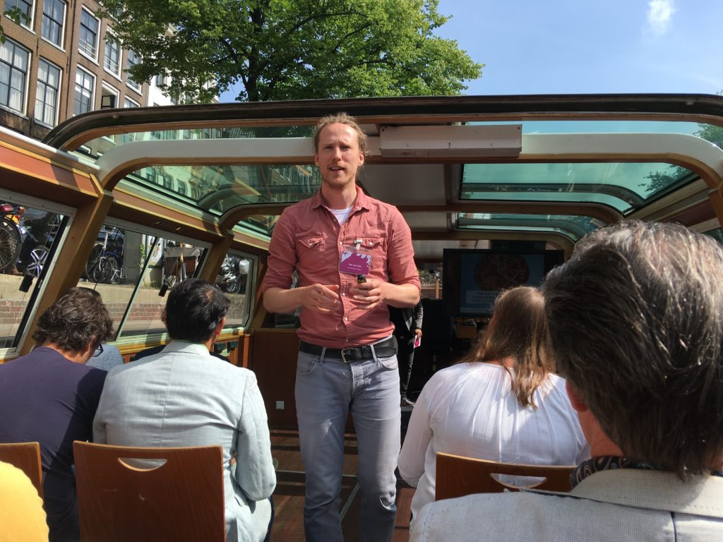 Tim van der Zee lecturing on a boat